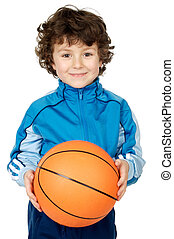 adorable child playing the basketball a over white...