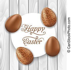Greeting card with Easter chocolate ornamental eggs on wooden background