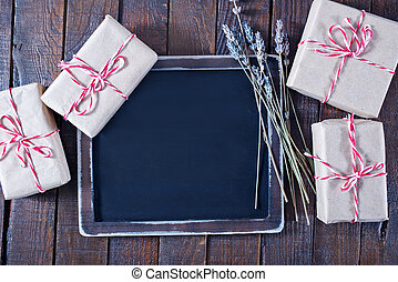 presents and black board on a table