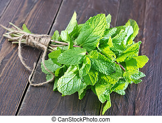 fresh mint on wooden tray and on a table
