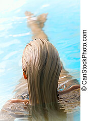 Beautiful young woman in spa - Back view of a beautiful...