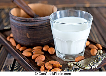 almond milk in glasses and on a table