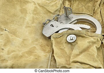 Handcuffs in The Camouflage Army Pants Pocket or Haversack...