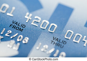 close up stacking credit cards , selective focus by very...