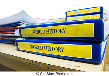 text books on a desk in a classroom