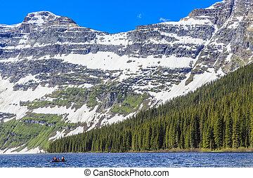 Boating at Cameron Lake - Nestled in a glacial basin,...