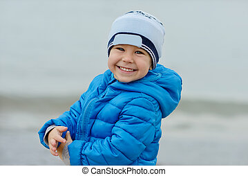 happy boy - happy toddler boy outdoors wearing blue jacket