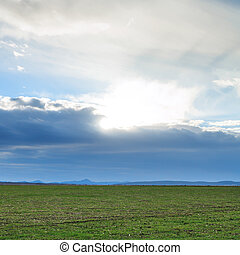 evening clouds over agricultural fields in spring