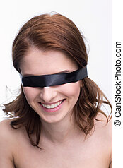 Young smiling woman with black blindfold