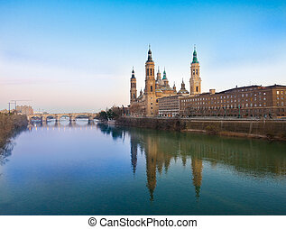 El Pilar in Zaragoza - El Pilar and the stone bridge in...