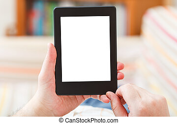 man read with e-book reader with cut out screen in living...