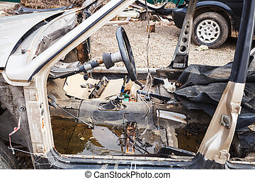 disassembled car at an automobile dump - old disassembled...
