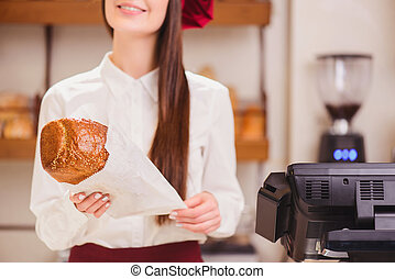 Beautiful young woman in a bakery - Come to our bakery again...