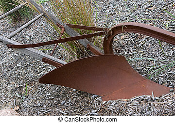 Old plough - An antique plough sits quiet in the dirt.