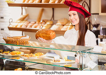 Beautiful young shop assistant in a bakery - Please enjoy...