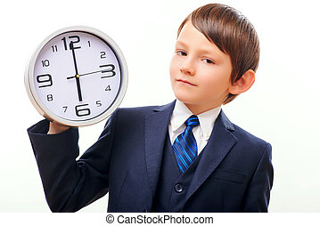 Business child in suit and tie posing with clock - Always in...