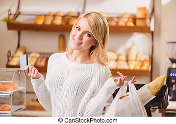 Beautiful young woman in a bakery - Great purchase Beautiful...