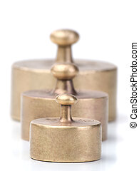 balance scale weights - three older and worn-out balance...