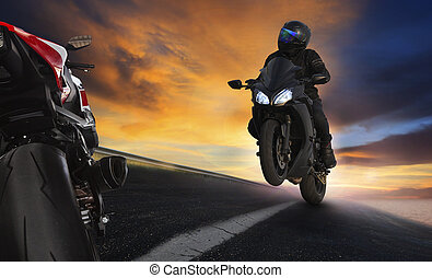 young man riding motorcycle on asphalt highways road with...