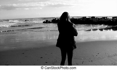 Young teenager looking the beach black and white