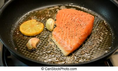 Fry salmon - Fresh salmon steak fry in a pan with butter,...