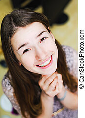 face of cheerful smile positive young woman