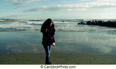 Girl looking ocean in tempest - Sad girl observing in the...