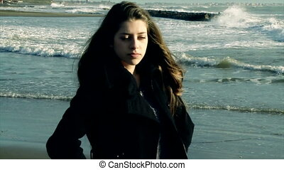 Girl looking ocean in tempest - Unhappy teenager feeling sad...