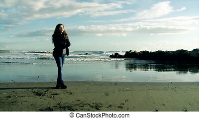 Girl looking ocean in tempest slow - sad girl looking waves...