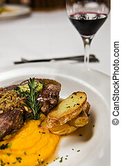 Restaurant Food - Meat, potato and pumpkin puree, served...