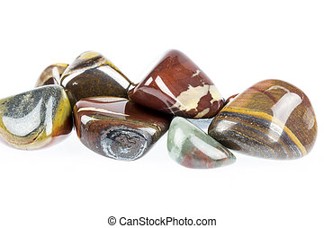 Polished tigers eye gemstone - Close up of Polished tigers...