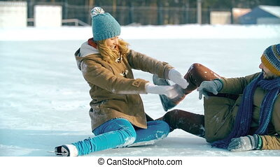 Lost the Balance - Couple just fallen down on ice at the...