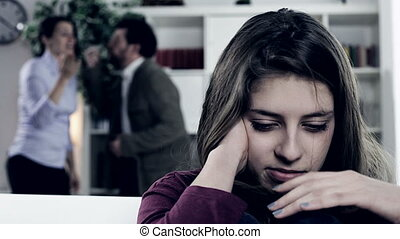 Parents fighting strong - Sad scared girl listening parents...