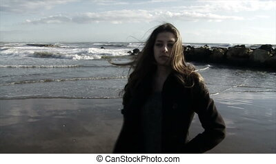 Sad teenager walking on the beach - Troubled teenager sad on...