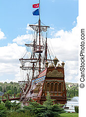Pirate Ship - Pirate ship in park on cloudy background.