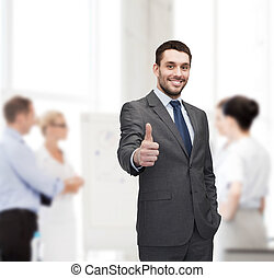 handsome buisnessman showing thumbs up in office - business,...