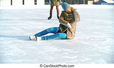 Love is in the Air - Pretty girl sitting on ice in skates...