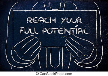 business man holding sign saying Reach your full potential