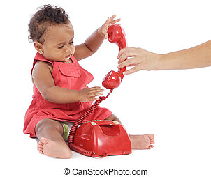 Baby girl with phone - Cute baby girl holding a red phone