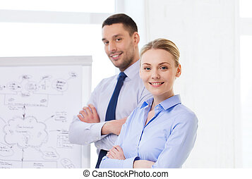 smiling business people in office - business, teamwork and...