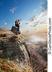 Tourist on rock
