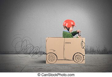 Cardboard car - Creative baby plays with his cardboard car