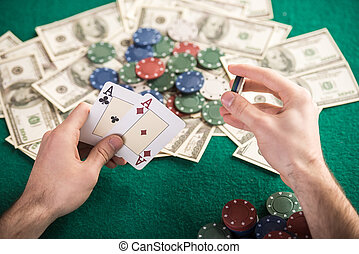 Poker game - Top view of a poker table during a game. Chips,...