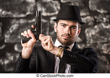 Gangster - Confident, gangster man in suit and hat is...