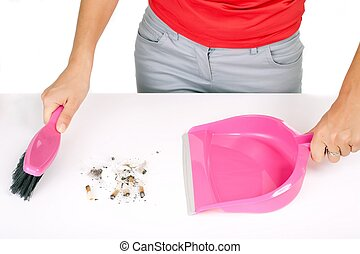 dustpan sweeping - woman sweeping cigarettes butts with...