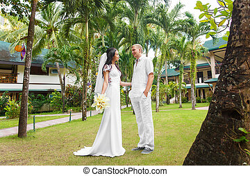 Bride and groom in the hotel on a tropical island Wedding...