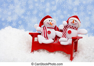 Happy Holidays - A red chair with snowmen sitting on snow...