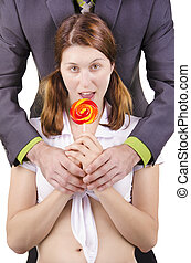 Young woman with lollipop, isolated on white.