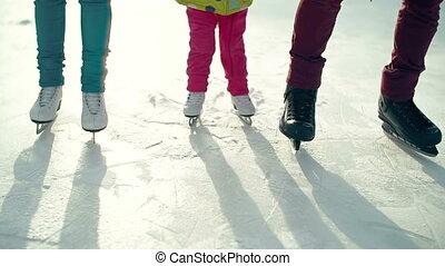 First Time Skating - Tilt up of little child skating...
