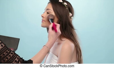 beauty woman having makeup done - beauty woman having her...